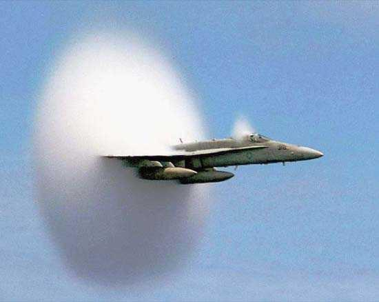 F/A-18 Hornet creates a shock wave as it breaks the sound barrier July 7 1999.